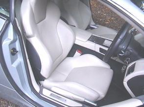 обзор Астон Мартин Aston Martin DB9 Coupe 2005. Кликните для просмотра фото автомобиля большего размера.