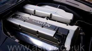 на дороге Астон Мартин Aston Martin DB7 Coupe 1996. Кликните для просмотра фото автомобиля большего размера.