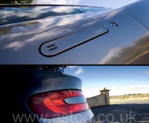 на дороге Астон Мартин Aston Martin DB9 2005. Кликните для просмотра фото автомобиля большего размера.