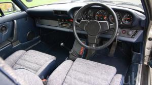 фотография Порше Porsche 911 SC Coupe 1982. Кликните для просмотра фото автомобиля большего размера.