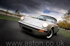 вид Порше Porsche 911 SC Coupe 1982. Кликните для просмотра фото автомобиля большего размера.