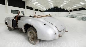 роскошный Астон Мартин DB1 1950. Кликните для просмотра фото автомобиля большего размера.